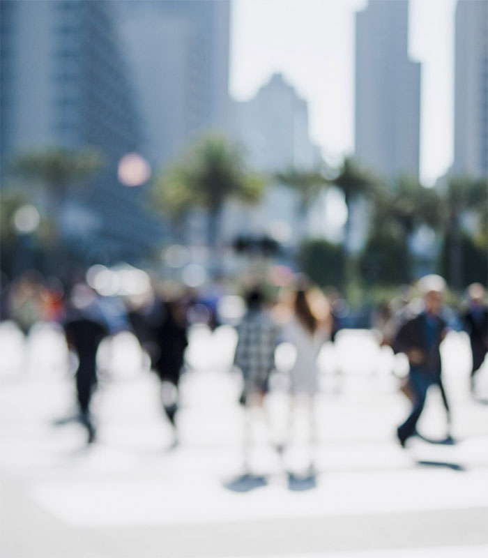 Blurred image of people in city