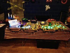 Table displaying Halloween decorations and candy