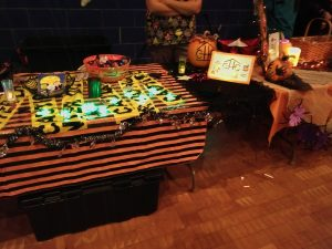 CHC table displaying Halloween decorations and candy